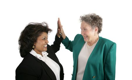 eachother: A diverse female business team giving eachother high-fives.  Isolated on white.