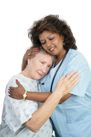 A loving medical professional comforting an elderly woman.  Isolated on white.