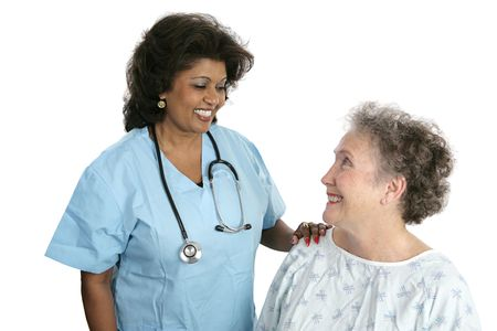 nursing staff: A pretty indian doctor bonding with her elderly patient.  Isolated on white.