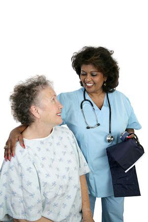 nursing staff: A friendly nurse caring for an elderly hospital patient.  Isolated on white with room for text. Stock Photo