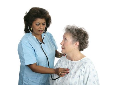 A worried patient with a doctor listening to her chest.  Isolated with focus on the patient's face. Stock Photo - 1406708