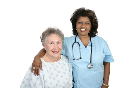 A senior woman with her caring nurse.  Isolated on white. photo