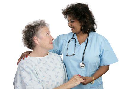 minor�a: Un paciente anciano y un cuidado m�dico o enfermera. Aislado en blanco.  Foto de archivo