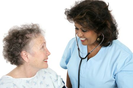 A caring nurse or doctor with a trusting patient.  White background.