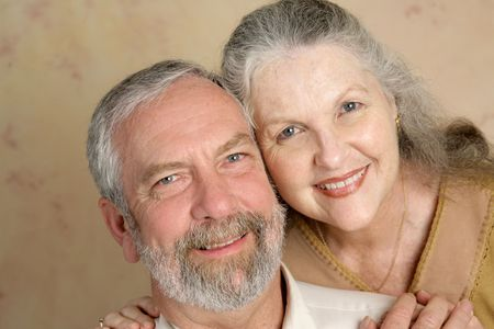 Portrait of a  beautiful gray haired middle aged couple in love. Stock Photo - 7565837
