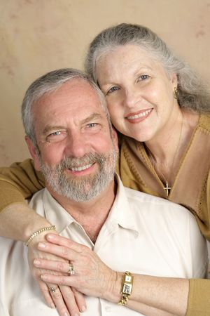 A beautiful, happy middle-aged couple in love.  Focus on her. Stock Photo