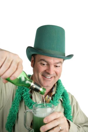 An Irish American man pouring himself a green beer.  Isolated on white. photo