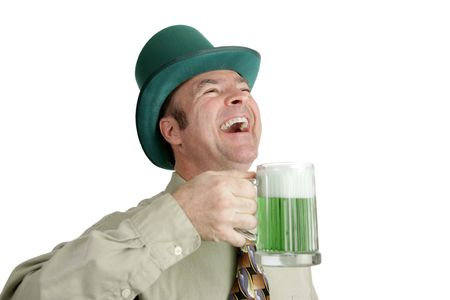 irish ethnicity: An Irish man on St. Patricks Day, enjoying a green beer and a good laugh.  Isolated on white.