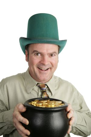 A man celebrating St. Patricks Day holding a pot of gold.  Isolated on white. photo