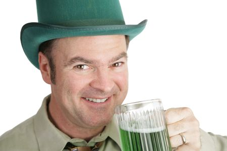 paddys: A handsome Irish American man with green beer on St. Patricks Day.  White background.