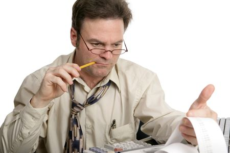 concentrating: An accountant concentrating on his calculations.  Isolated on white. Stock Photo