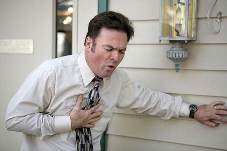 A middle aged man outside his office suffering from a persistent cough.