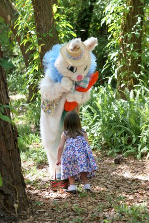 buck teeth: The Easter Bunny having a conversation with a little girl.