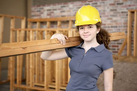 A young female apprentice working on a construction site. photo