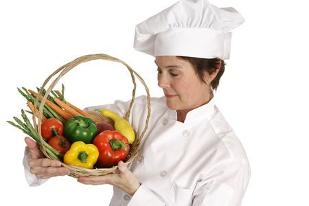 A chef inspecting a basket of fresh vegetables.  Isolated on white. Stock Photo - 806086