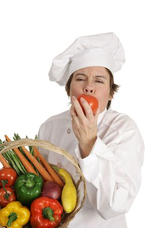 A chef biting into a ripe tomato with a look of pleasure on her face.  Isolated on white. Stock Photo - 806088