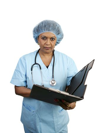 A surgical nurse looking serious as she reviews a patient's chart. Stock Photo - 806091