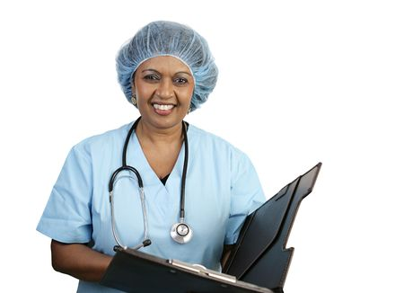 A pretty nurse in a surgical cap smiling as she reviews a chart.  Isolated on white Stock Photo - 806092