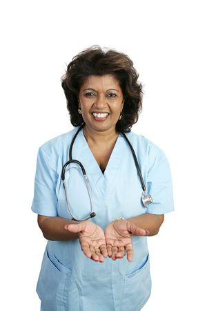 A doctor or nurse in scrubs holding out her hands palms up.  Isolated on white. Stock Photo - 806098