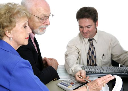 A senior couple going over their finances with an accountant.  Isolated with focus on senior man.   photo