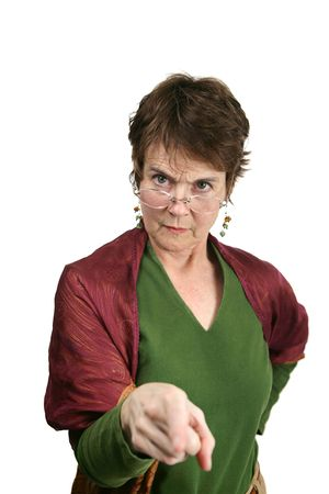 A bossy, angry looking middle aged woman pointing her finger at you.  Isolated on white.