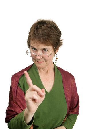 mean: An attractive middle aged teacher correcting a student kindly but firmly.  Isolated on white. Stock Photo