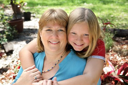 Portrait of a pretty blond mother and daughter in the garden. Stock Photo - 806130