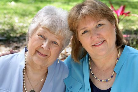A grown woman and her senior mother.  Focus is on the adult daughter. Stock Photo - 806132