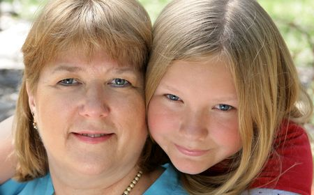 Closeup portrait of a pretty blond, blue-eyed mother and daughter. Stock Photo - 806133