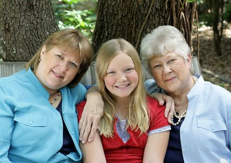 Three generations - a little girl, her mother, and her grandmother.  All with blond hair and blue eyes. Stock Photo - 806180
