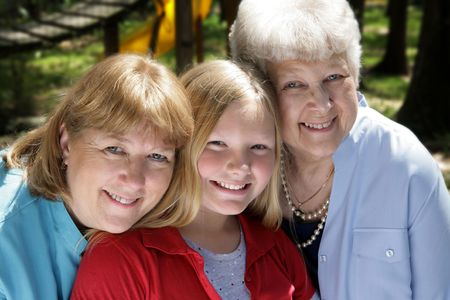 Three generations, a grandmother, mother, and daughter in the park. Stock Photo - 806181