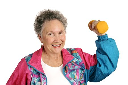 tracksuit: A friendly, smiling senior woman in a tracksuit working out with freeweights.  Isolated on white.