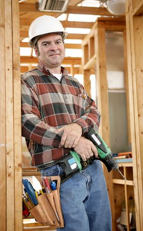 jobsite: A handsome construction worker on the jobsite with his tools, ready to work.  Authentic and accurate content depiction.
