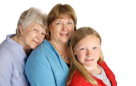 A beautiful grandmother, mother, and little girl with a very strong family resemblance.  Isolated on white. Stock Photo - 836525