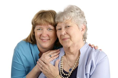 A warm loving portrait of an adult daughter and her elderly mother.  Isolated on white.   Stock Photo - 836521