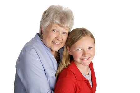 A happy grandmother and granddaughter together. Isolated on white. photo