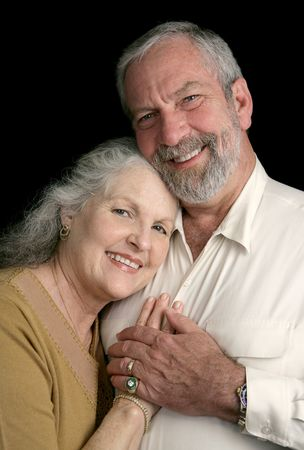 Portrait of a happy, successful middle aged couple over a black background. Stock Photo - 868463