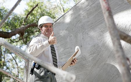 A construction inspector giving a thumbsup to show the building passed inspection. photo