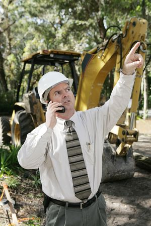 An engineer giving orders on a construction site. Stock Photo - 877095