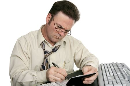 A man concentrating on balancing his checkbook.  Isolated on white.