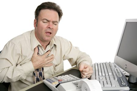 experiencing: A man in his forties experiencing chest pain while working in his office. Isolated on white.