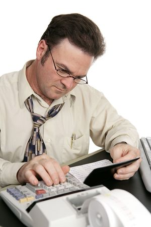 bank records: A man using a calculator to balance his checkbook.  Isolated on white.