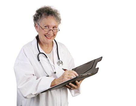 A friendly, mature female doctor making a note in a patients chart.  Isolated on white. photo