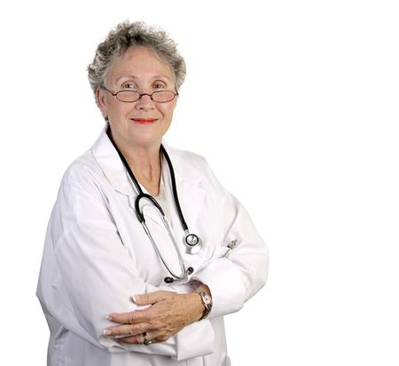 A mature, competent looking female doctor isolated on white. photo
