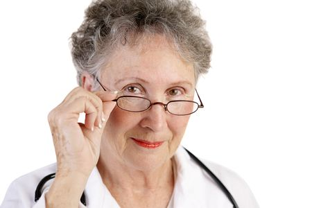 A trustworthy, mature female doctor.  Closeup over white background. photo