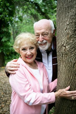Portrait of a happy loving senior couple together in the park.