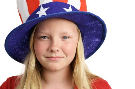 Portrait of a beautiful young American girl wearing a patriotic hat.  Isolated on white. Stock Photo - 935993