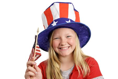 A pretty little girl in a patriotic hat waving an American flag.  Isolated on white.   photo