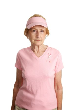 A senior woman in pink with a breast cancer awareness ribbon.  Shes serious about beating the disease. photo