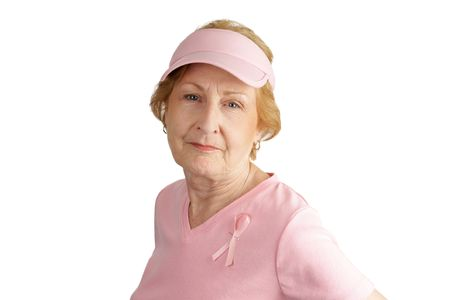 A  senior woman dressed in pink and wearing a breast cancer awareness ribbon.  Isolated on white. photo